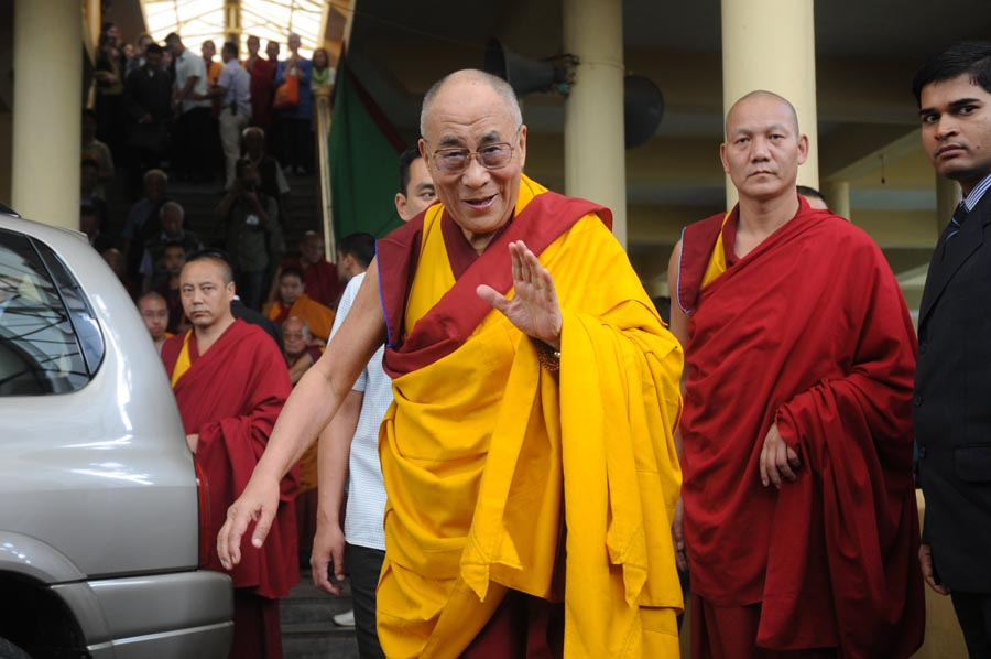 Tibetan spiritual leader the Dalai Lama leaves Tsuglakhang temple after a teaching session in McLeod Ganj, India, on 4 September 2012. The Dalai Lama will deliver lectures on Buddhist philosophy for three days at the request of devotees from southeast Asia.